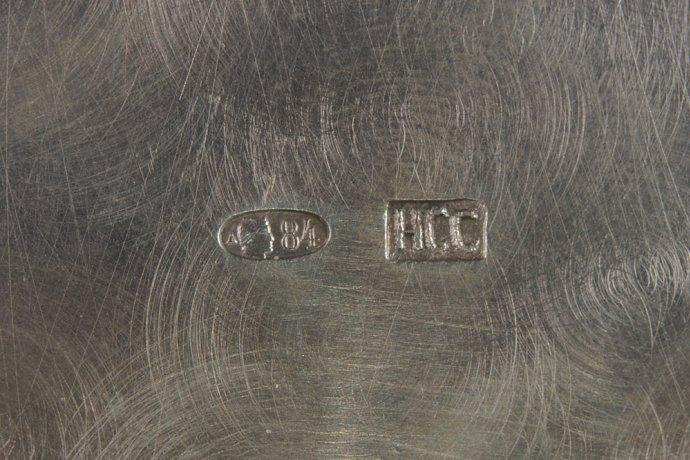 Проба с изображением женщины в кокошнике (повернуто вправо). Изделие выпущено в конце 19 в. – начале 20 в.